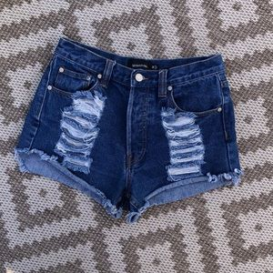 High waisted button up medium wash jean shorts